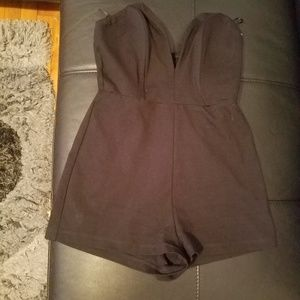 Black romper pre owned size M great condition